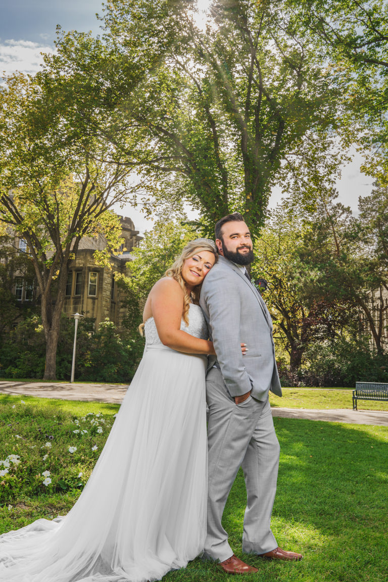 wedding couple in front of the university of saskatchewan