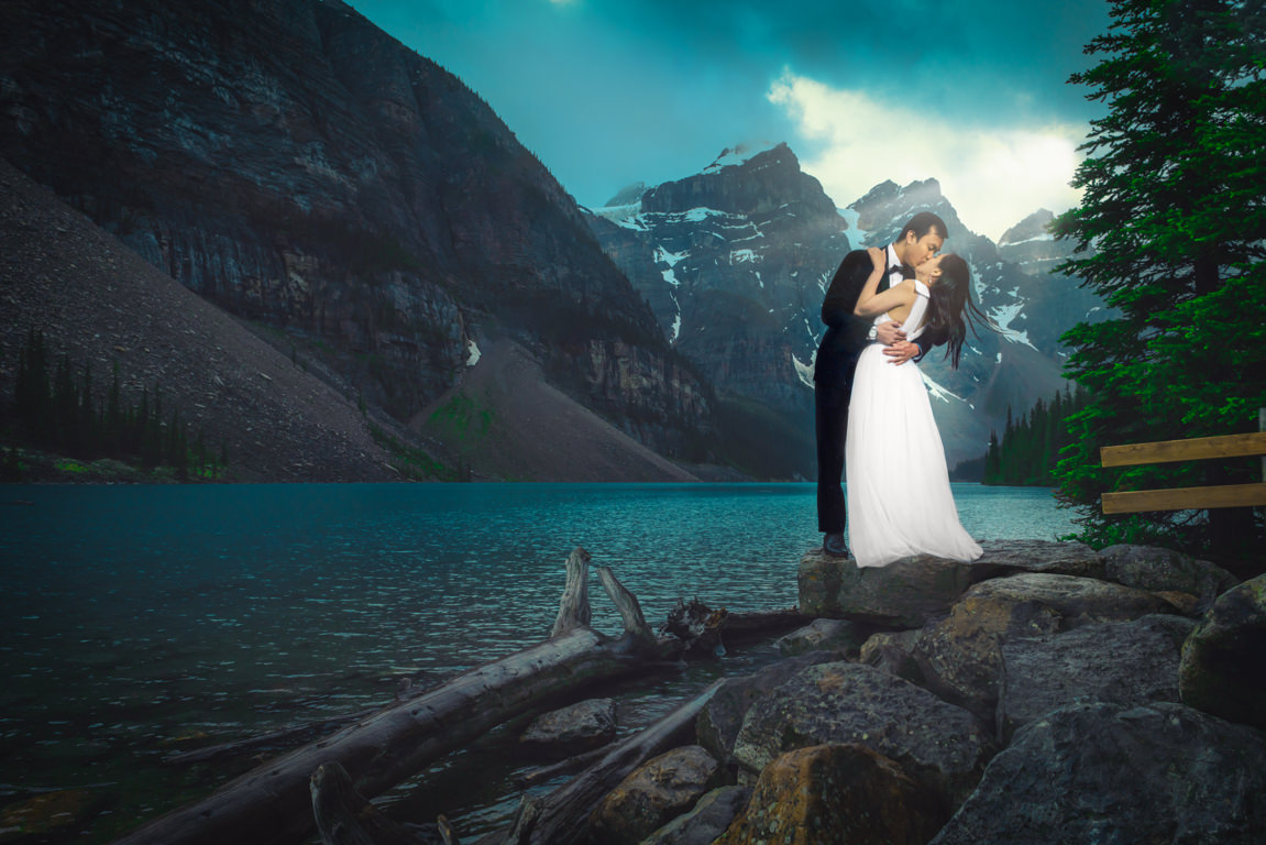 bride and groom at moraine lake with light shining on them