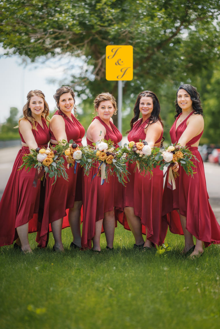 bridal party in front of sign