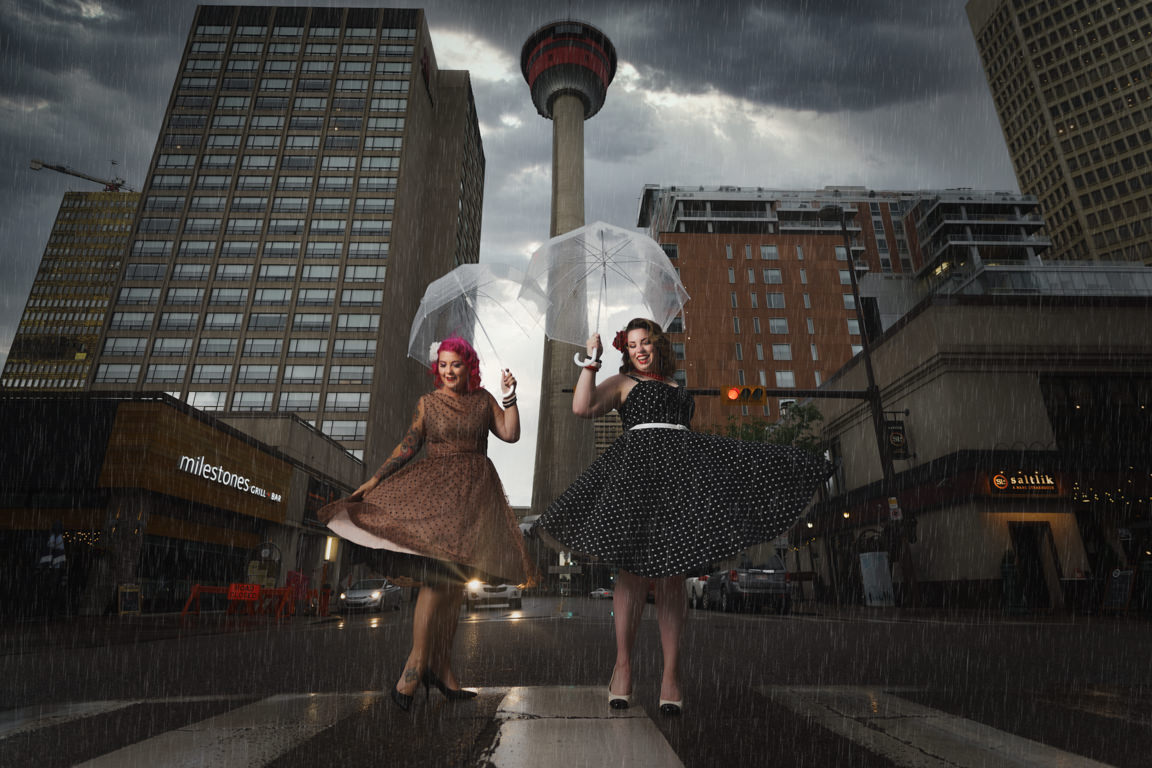 pin up girls in the rain at the base of the calgary tower