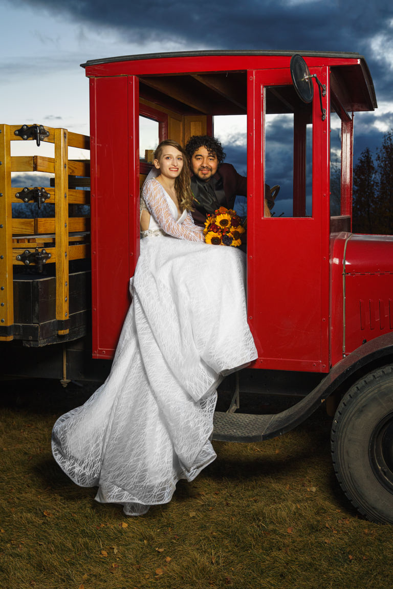 bride and groom in old truck