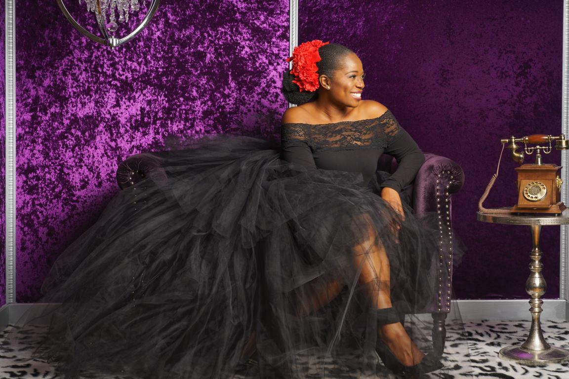portrait of woman in a purple velvet room