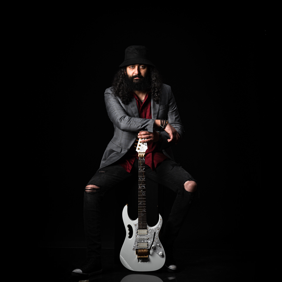 sitting metal musician with guitar