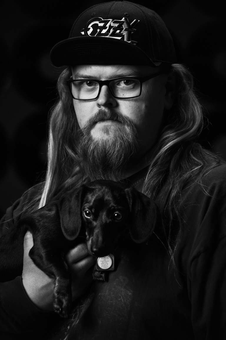 a man, dog, and his vinyl records at snap foto club