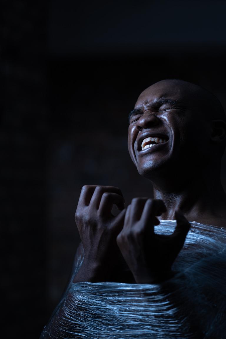 black man in saran wrap