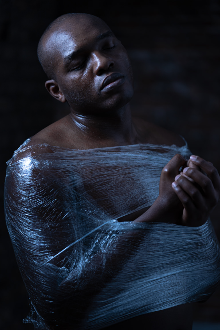 black man in cling wrap