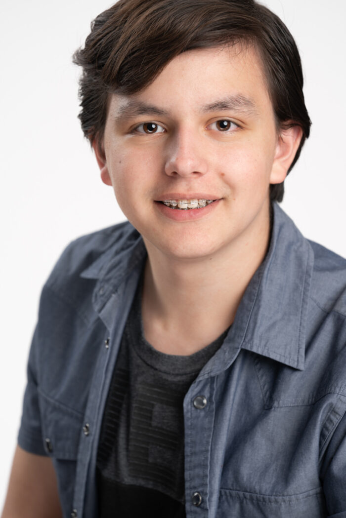 smiling actor headshot on white background