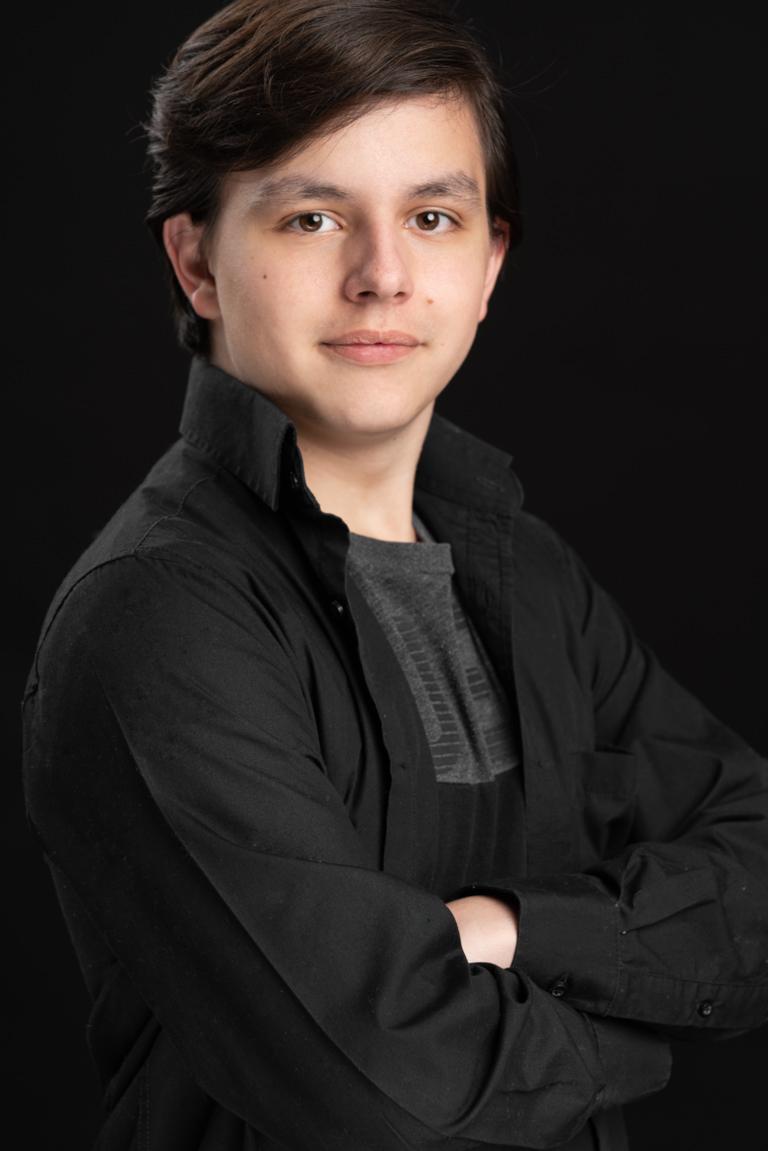 actor headshot on black background